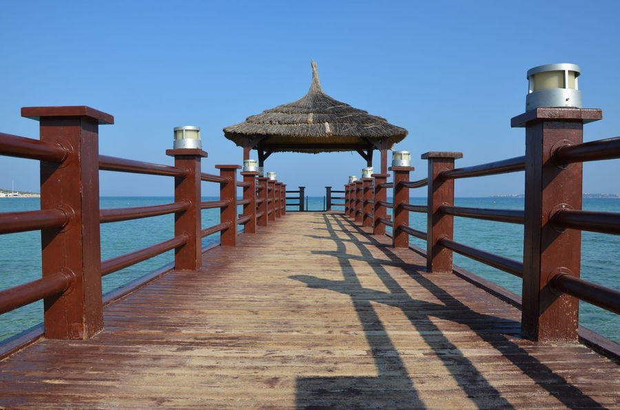 Architecture Clear Sky No People Outdoors Pier Sea Sky Summer Tourism Travel Destinations Vacations Wood - Material Holiday Been There.
