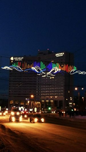 Azimut Arctica Hotel on the Main Square of Murmansk, Russia. Guirlande Night Lights Darkness And Light Cityscapes