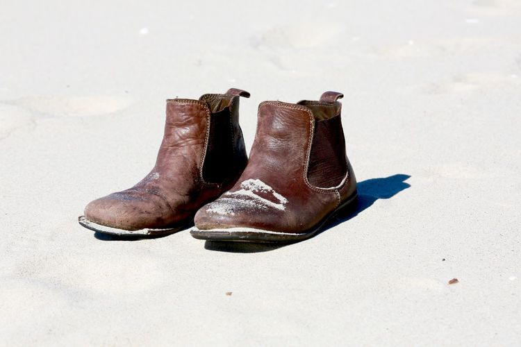 Leather boots on beach
