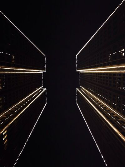 Illuminated tunnel at night