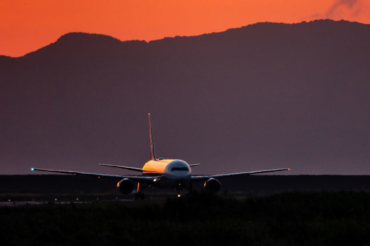 Aerospace Industry Air Vehicle Airplane Airport Airport Runway Dusk Environment Flying Journey Mid-air Mode Of Transportation Motion Nature No People Outdoors Public Transportation Sky Sunset Taking Off Transportation Travel