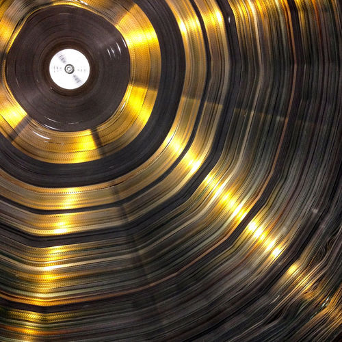 Abstract Arts Culture And Entertainment Backgrounds Circle Directly Above Film Reels No People Pattern Reel Shiny