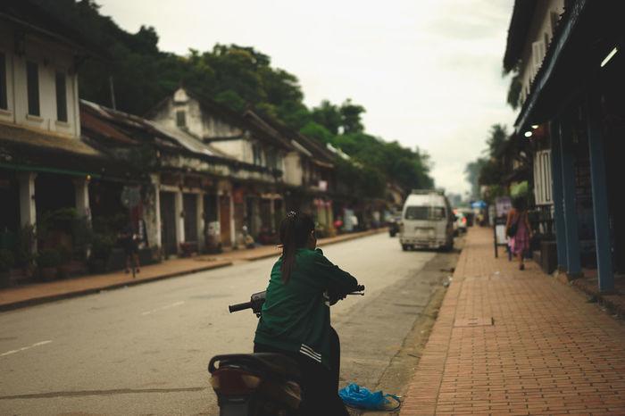 Luang Prabang, Laos Motorcycle Girl Waiting Girl Waiting On Motorbike Girl Waiting On Motorcycle Laos Laos Street Laos Street Photo Luang Prabang Motorbike Sisavangvong Road Street Street Photography Street Scene Street Scenes Streetphotography Transportation