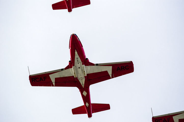 Snowbirds At The Air Show Aerospace Industry Air Vehicle Airplane Clear Sky Day Fighter Plane Flying Low Angle View Mid-air Military Mode Of Transportation Motion Nature No People on the move Outdoors Plane Red Sky Transportation