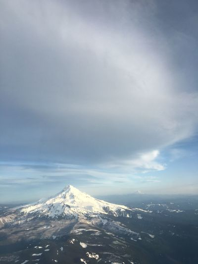 The Mount Hood from the sky Nature Beauty In Nature Sky Mountain Scenics Cloud - Sky Weather Snow Cold Temperature Tranquility Tranquil Scene Outdoors No People Day Winter Landscape Mountain Range Sea Snowcapped Mountain BYOPaper! EyeEmNewHere Perspectives On Nature