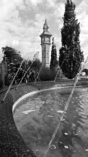 The fountain and clock tower in the centre of town. Black And White Scenery Clock Tower Water Fountain