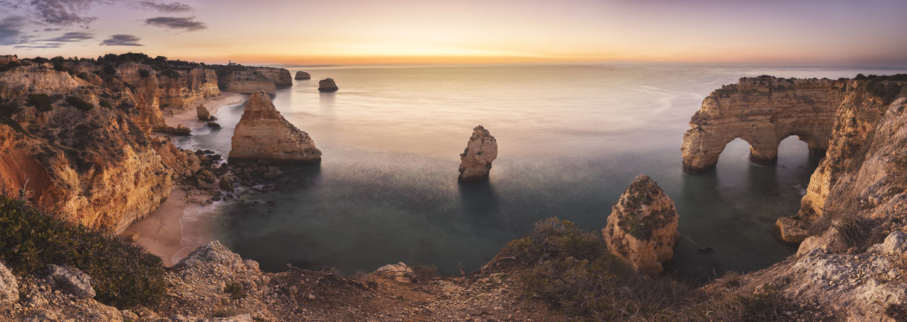 Panoramic view of sea and rocks during sunset
