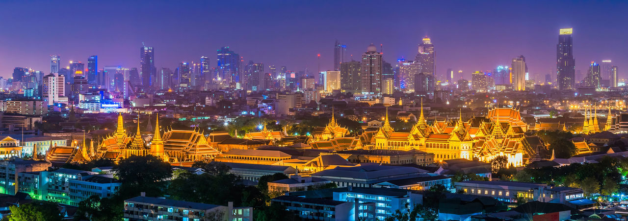 Panorama view of Grand palace and Wat phra keaw or Emerald Buddha temple with Bangkok downtown building in background in Bangkok,Thailand Bangkok Cityscape Emerald Buddha Temple Panorama Thailand Travel Wat Phra Kaew Aerial View Architecture Building Exterior Built Structure City Cityscape Illuminated Landmark Landscape Modern Night Outdoors Panoramic Skyscraper Temple Travel Destinations Urban Skyline View From Above
