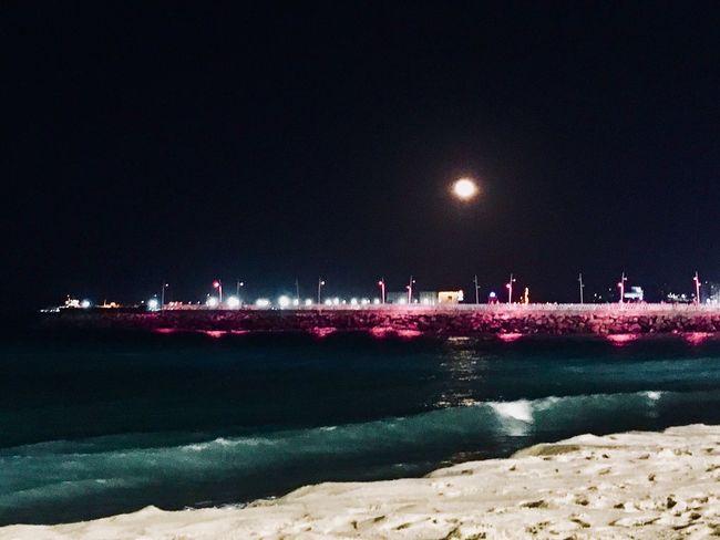 Outubro rosa 🌹 Night Illuminated Water Outdoors Sea Sky Beach No People City