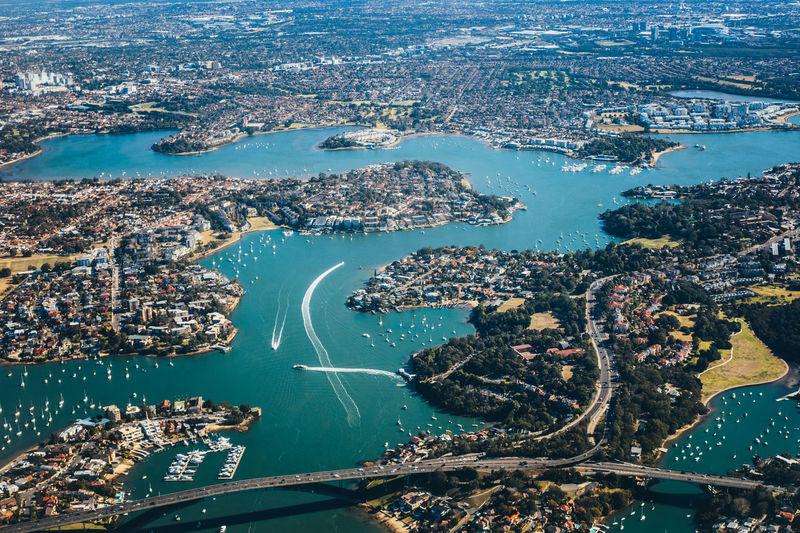 Aerial view of buildings by sea