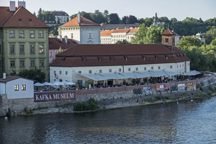 Kafka museum Architecture Building Building Exterior Built Structure Canal City Cover Day Kafka Museum Outdoors Outside Cafe People Residential Building Residential District Residential Structure River Riverside View Shade Sky Summer Evening 2015 Town Travel Destinations Water Waterfront