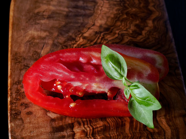 Basil Close-up Cutting Board Food Food And Drink Freshness Healthy Eating Herb High Angle View Indoors  Leaf Meal Meat No People Plant Part Ready-to-eat Red Red Meat Still Life Table Tomato Vegetable Wood - Material