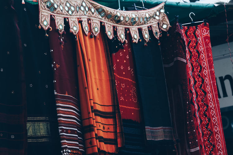 Close-up of clothes hanging in market stall