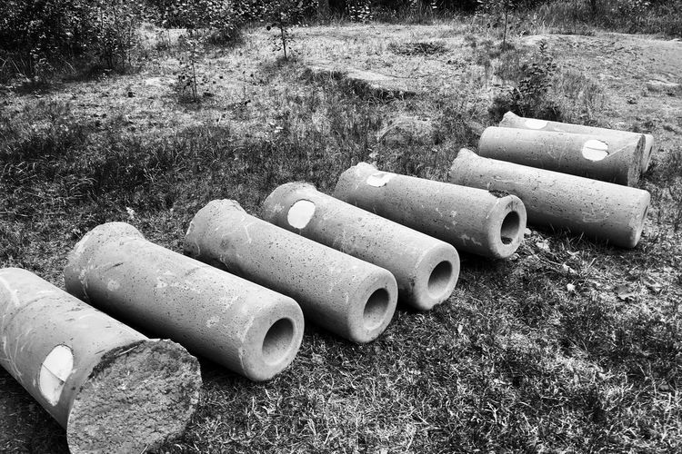EyeEm Selects Grass Field Day Outdoors Large Group Of Objects Stack No People Pipe - Tube Plant Concrete Plinths Nature Stockholm Sweden Streetphotography Blackandwhite Monochrome Bnw