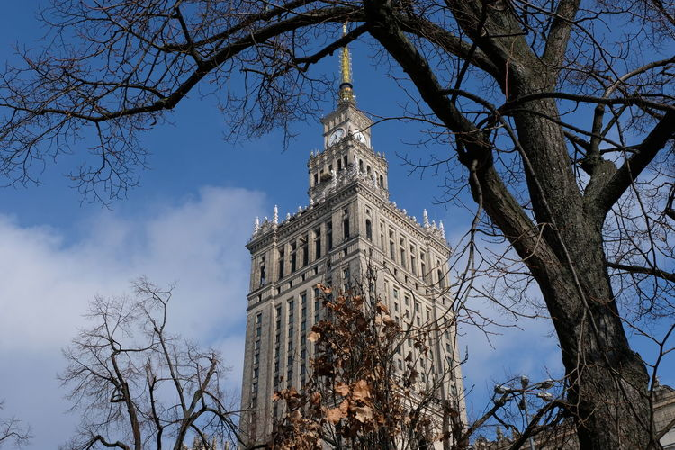 Poland Pologne Stalinist Architecture Towers And Sky Warsaw Warsaw Poland Architecture Building Exterior Built Structure Clock Low Angle View Tower Travel Destinations Tree Varsovie Warsaw Centrum Warsawa Warsawarchitecture