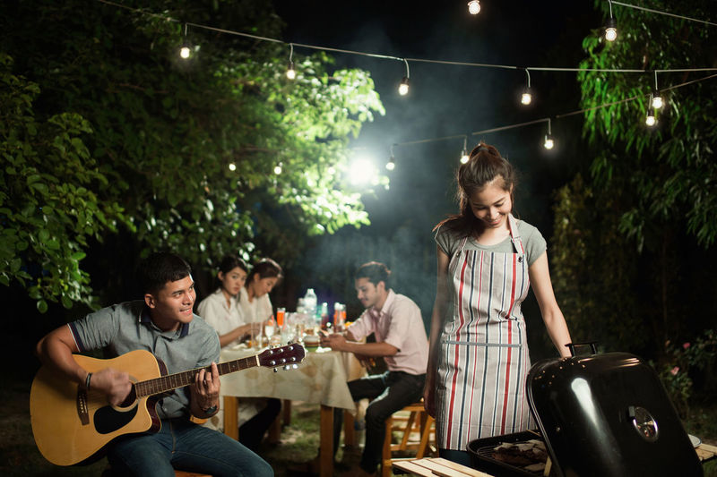 Artist Arts Culture And Entertainment Casual Clothing Enjoyment Friendship Group Of People Guitar Happiness Leisure Activity Men Music Musical Instrument Musician Performance Playing Real People Stage String Instrument Togetherness Young Adult Young Men
