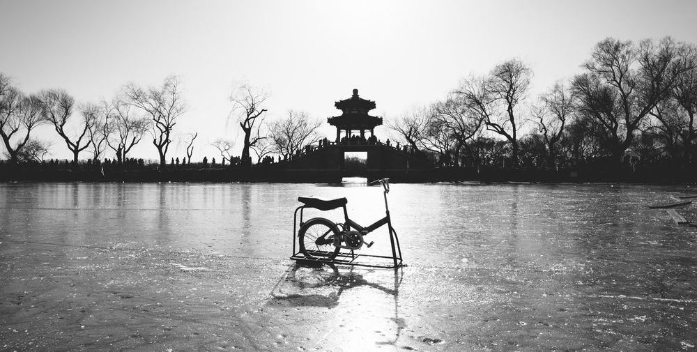 Bicycle on the ice lake Beauty In Nature Day Lake Nature No People Outdoors Silhouette Sky Tranquility Tree Water
