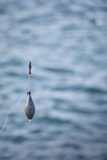 Close-up of fishing net on sea