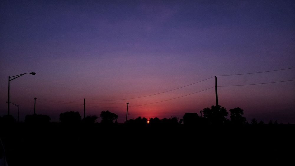 A day in the life photo essay. Summer solstice June 2016 Friend, Nebraska A Day In The Life Beauty In Nature Camera Work Colorful Electricity  Fuji X100s Fujifilm Lowlight MidWest Nebraska Nebraska Sunsets  No People Outdoors Photo Essay Purple Rural America Scenics Silhouette Sky Small Town Small Town USA Solstice Sundown Sunset Tranquility