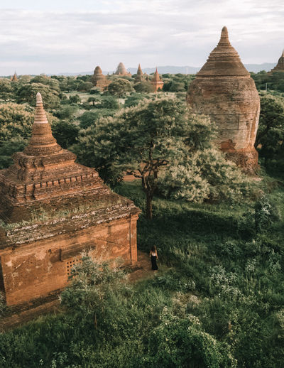 Woman at temples in Bagan, Myanmar Drone  Mandalay Ancient Ancient Civilization Archaeology Architecture Bagan Bagan, Myanmar Building Building Exterior Built Structure Burma Dametraveler Drone Photography Droneshot History Landscape Myanmar One Girl One Woman Only Outdoors Place Of Worship Small Person The Past Tree