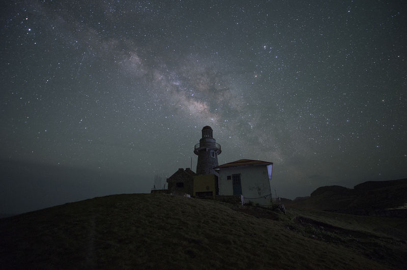 Low angle view of sabtang lighthouse against star field at night
