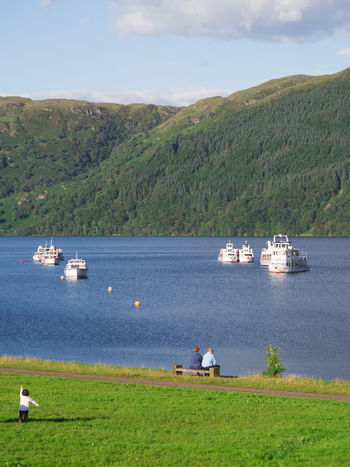 Happy Couples at Loch Lomond Captain Haddock Couple Scotland Beauty In Nature Boat Cloud - Sky Day Grass Loch Lomond Mountain Nature Nautical Vessel Outdoors Scenics Ship Sky Tintin Tranquility Transportation Tree Water