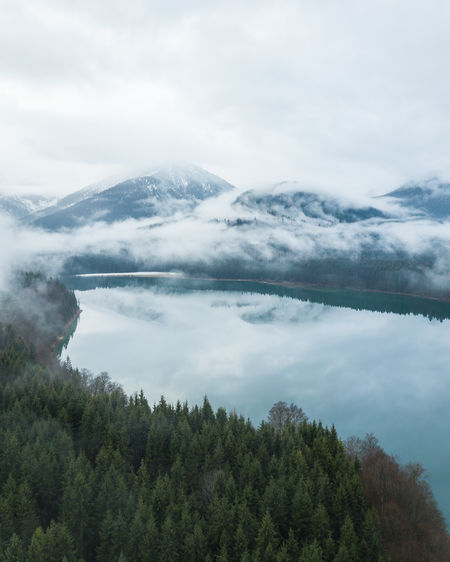 Sylvensteinspeicher captured with a drone. Bayern, Germany. My Best Photo Cloud - Sky Sky Beauty In Nature Tranquility Scenics - Nature Tranquil Scene Day Nature No People Fog Outdoors Sylvensteinspeicher Lake Drone  Dronephotography Lake View Forest Wood And Water Blue Water Water Reflections Tree Plant Mountain