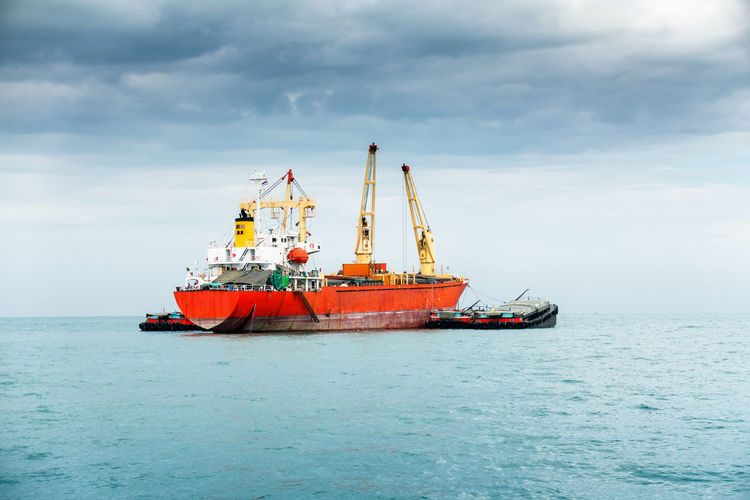 Shipping Business Goods Industrial Logistics Transport Transportation Cargo Cloud - Sky Day Horizon Over Water Industry Loading Nature Nautical Vessel Ocean Oil Industry Outdoors Scenics Sea Shipping  Shipping Docks Sky Storm Cloud Water Waterfront