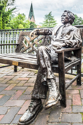 Mark Twain in Lüneburg Author Bank Bench Day Legs Marktwain Metal Metallic Outdoors Relaxed Sculpture Sitting Sky Statue Stjohannis Tree Twain Waiting Writer