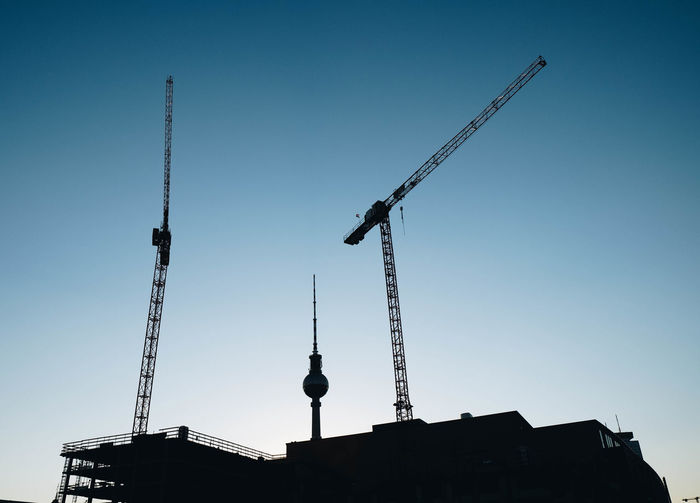Building Berlin. Fernsehturm Architecture Building Building Exterior Built Structure Clear Sky Construction Equipment Construction Industry Construction Site Crane Crane - Construction Machinery Day Development Industry Low Angle View Machinery Nature No People Outdoors Silhouette Sky Spire  Tall - High Tower