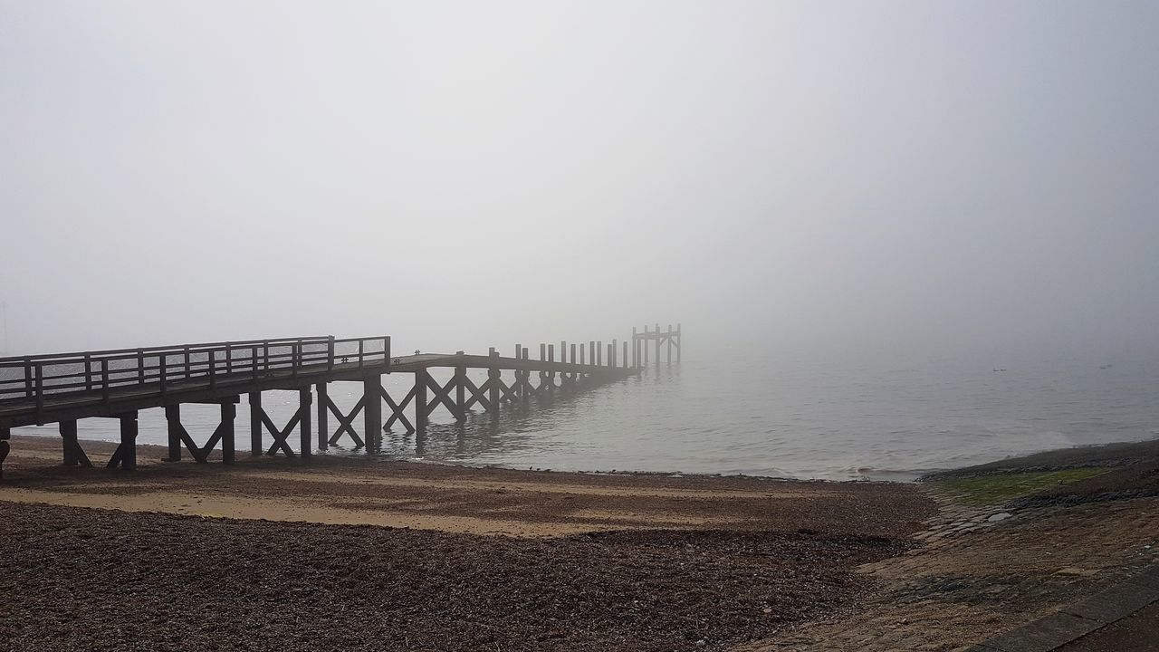 fog, copy space, sea, foggy, scenics, nature, outdoors, day, water, tranquil scene, tranquility, beauty in nature, mist, beach, horizon over water, no people, sky