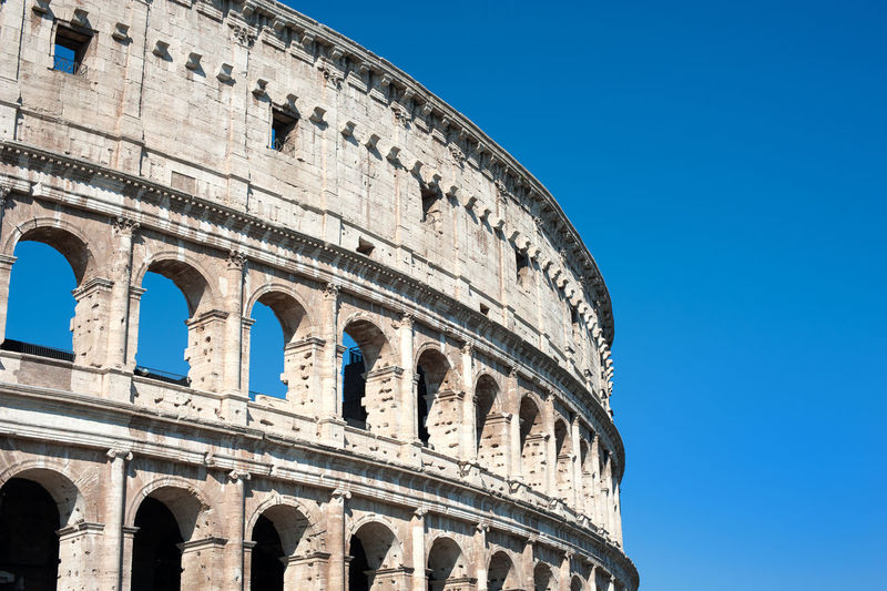 Low angle view of coliseum against sky