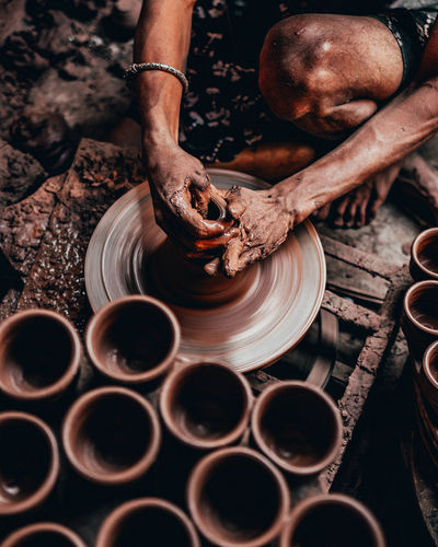 making pots. Street Photography Street Life Street Scene Lost Traditions Mumbai Streetphotography Human Hand Men Working Clay Occupation Close-up Pottery Molding A Shape Pot Mud Muddy Soil Human Leg Spinning Craft Product My Best Photo The Street Photographer - 2019 EyeEm Awards