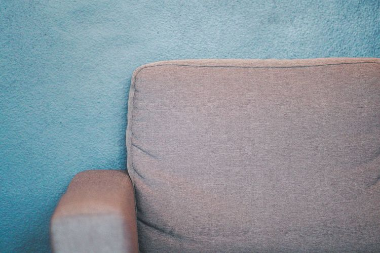Close-up of sofa against wall