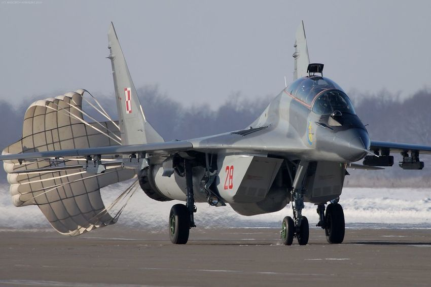 Aerospace Industry Air Force Air Force Air Vehicle Airplane Airshow Army Day Fighter Fighter Plane Jet Fighter Landing Mig-29 Mikoyan I Gurevich Mikoyan Mig-29 Military Military Airplane Outdoors Parachute People Runway Snow Transportation Winter