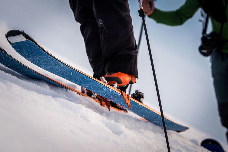 People skiing on snow against sky