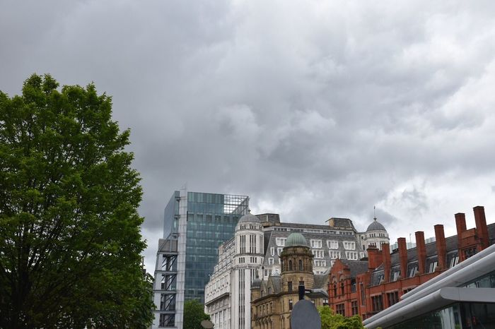 Investing In Quality Of Life Low Angle View Architecture Cloud - Sky Sky Day Building Exterior Built Structure No People Outdoors Tree City Architecture Buildings Manchester Architecturephotography EyeEm Selects Nikon Cityscape EyeEm Architecture_collection EyeEm Masterclass Architectural Feature Modern Architecture Old Buildings