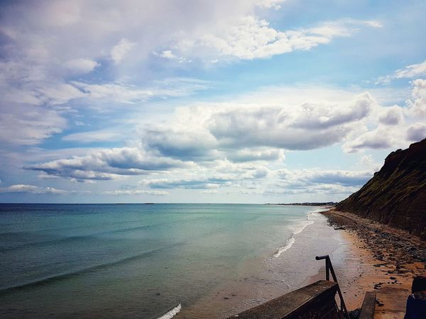 Sea Cloud - Sky Beach Water Sky Nature Scenics Horizon Over Water Outdoors Beauty In Nature Landscape Travel Travel Destinations Vacations No People Tranquility Sand Blue Day