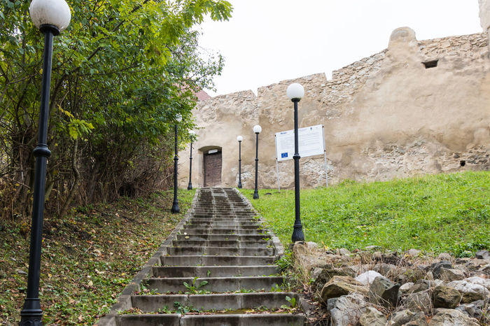 Near Sighisoara, Romania, October 08, 2017 : The staircase leading to the fortress wall of the Rupea Citadel on the road between Sighisoara and Brasov in Romania Ancient Architecture Gothic Ruins Rupea Castle Sighisoara-Romania Transylvania Travel Brashov Citadel Day Destination Europe Fort Fortification Fortress Heritage History Medieval Monument Old Outdoors Tourism Tower Vacation