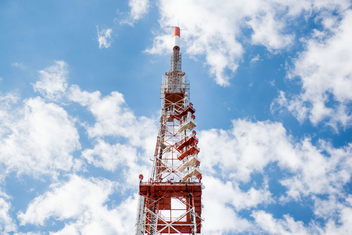 Telecommunication tower against blue sky Antenna Broadcasting Tower Built Structure Cloud - Sky Day Global Communications High Industry Low Angle View No People Outdoors Red Sky Technology Telecommunications Equipment TelecommunicationTower Tower