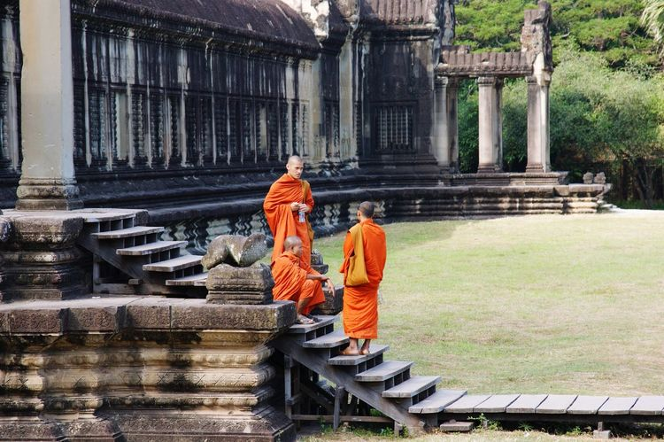 Buddhist monks EyeEmNewHere Angkor Wat Ancient Temple Temple Standing Stairs Steps Orange Orange Robes Buddhism Buddhist Monks Buddhist Monks Architecture Built Structure Religion Belief Spirituality Place Of Worship Real People Orange Color Clothing Men Building Building Exterior History Day People Travel Architectural Column EyeEmNewHere