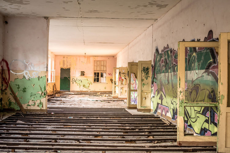 Day No People Abandoned Architecture Built Structure Staircase Building Indoors  Graffiti Wall - Building Feature Steps And Staircases Door Entrance Art And Craft Damaged Old Window Weathered Deterioration Messy Architectural Column Ceiling Lost Ruin