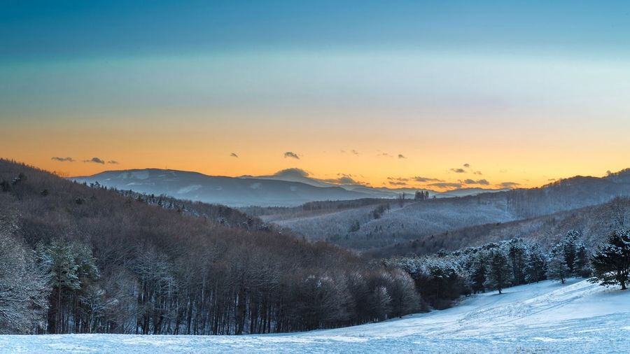Sunset mountain Cold Temperature Snow Winter Nature Beauty In Nature Mountain Tranquil Scene Landscape Sunset Scenics Outdoors No People Tranquility Tree Sky Mountain Range Day