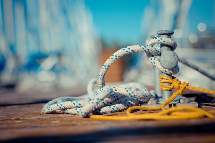 Close-up of rope tied up from cleat at harbor