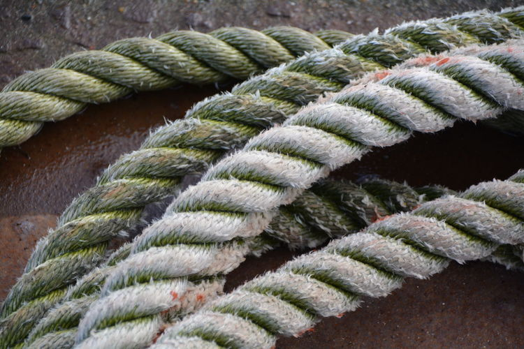 Close-up of ropes against rusty metal