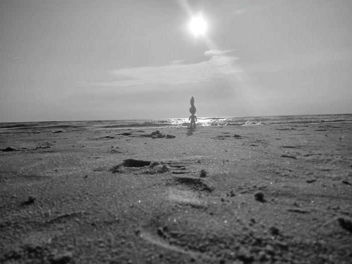 Figure on the beach shore Doll Siluet Black & White Blackandwhite Silhouette Sea Beach Sand Silhouette Sky Horizon Over Water Shore Coastline
