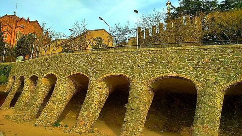 ViaductARCHITECT Gaudi Built By  Diverting The Original Road From  Sant Gervasi To  The Cemetery , In Order To  Preserve The Remaining Fragments Of The Two Towers ofthe castlemedievalTorre Bellesguard