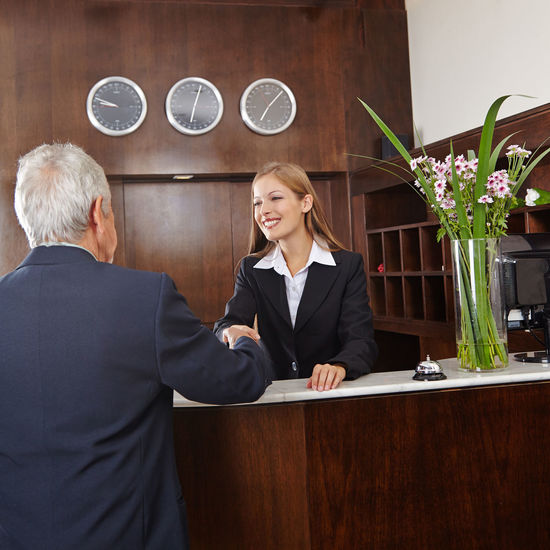 Business person having discussion at reception
