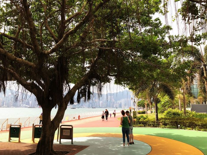 HongKong Ferry Terminal Couple Tree Honkong Tree People Real People Adult Full Length Growth Togetherness Water Outdoors Day Nature Lifestyles