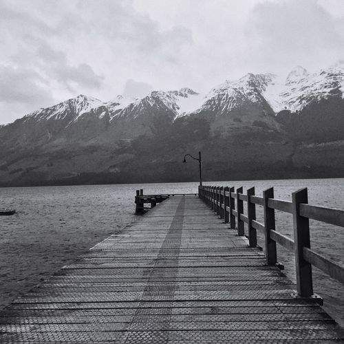 Jetty at Glenorchy Mountain Water Nature Beauty In Nature Sky Outdoors Tranquil Scene Scenics Day Tranquility Lake Mountain Range Snow No People Bridge Architecture Island Built Structure Leisure Activity Cold Temperature The Great Outdoors - 2017 EyeEm Awards